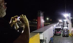 John photographing truck loading